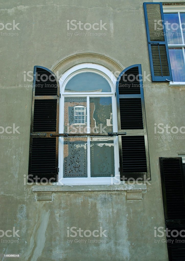 Arched Shuttered Window royalty-free stock photo