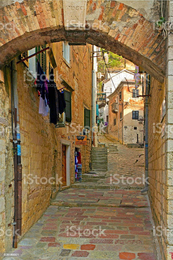 Arched sreet paved in stone, Kotor, Montenegro stock photo