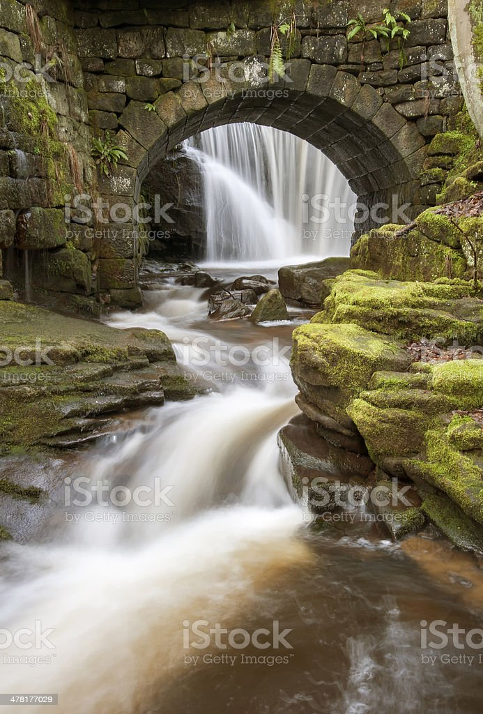 arched stone bridge and waterfall royalty-free stock photo