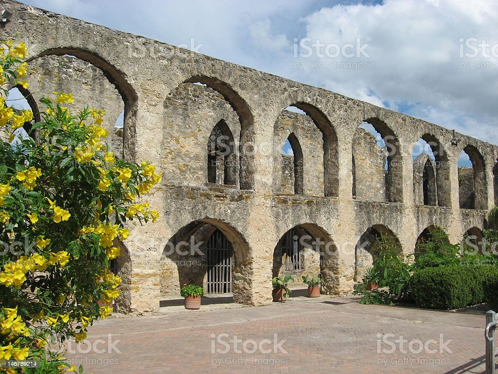 Arched stone mission walls stock photo
