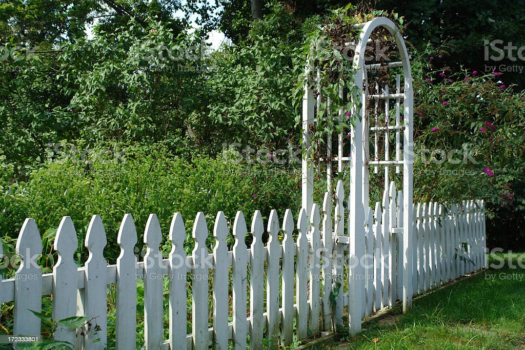 arched trellis entry to a garden royalty-free stock photo