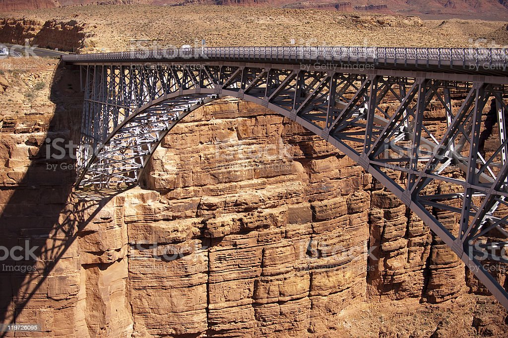 Arched trussed bridge crossing ravine royalty-free stock photo