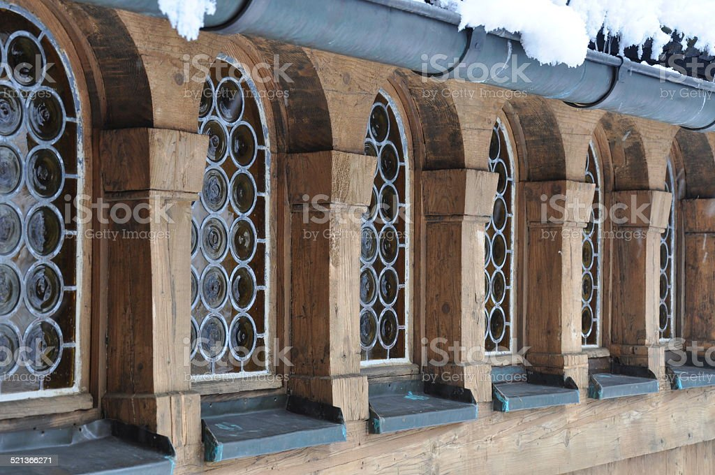 Arched window in a wooden house stock photo
