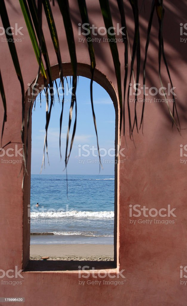 Arched Window Looking out in to Paradise stock photo