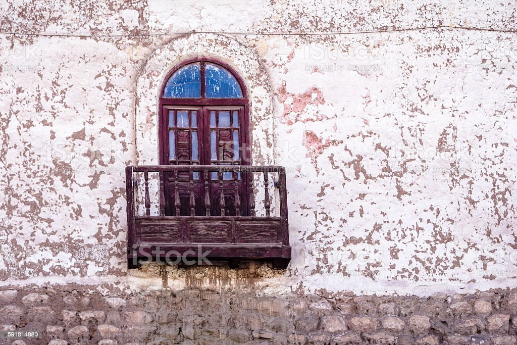 Arched window on old weathered building wall stock photo