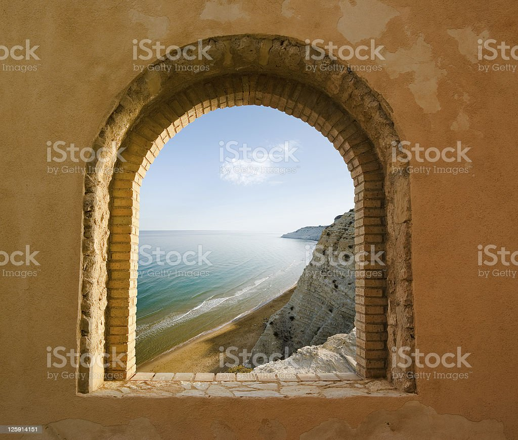 arched window on the coastal landscape of a bay royalty-free stock photo