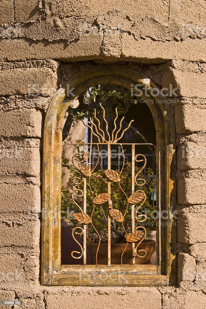 Arched Window with Detail, Adobe Brick, Southwest Pattern, Warm Tone royalty-free stock photo