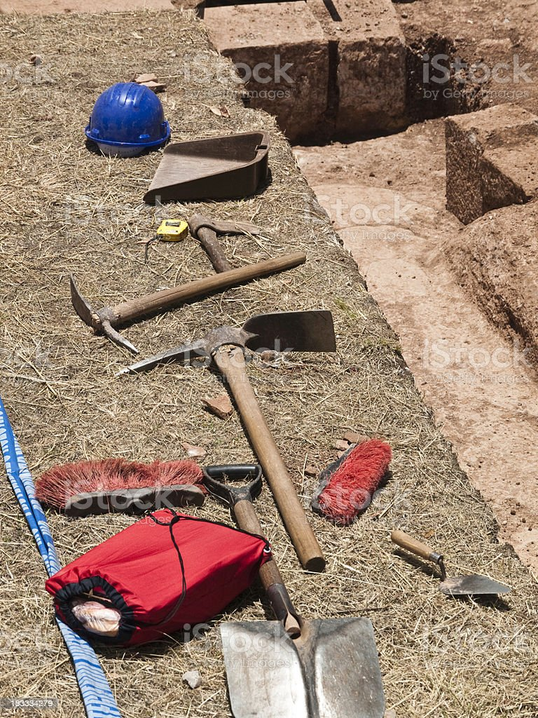 Archeology tools next to a dig stock photo
