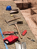 Archeology tools next to a dig