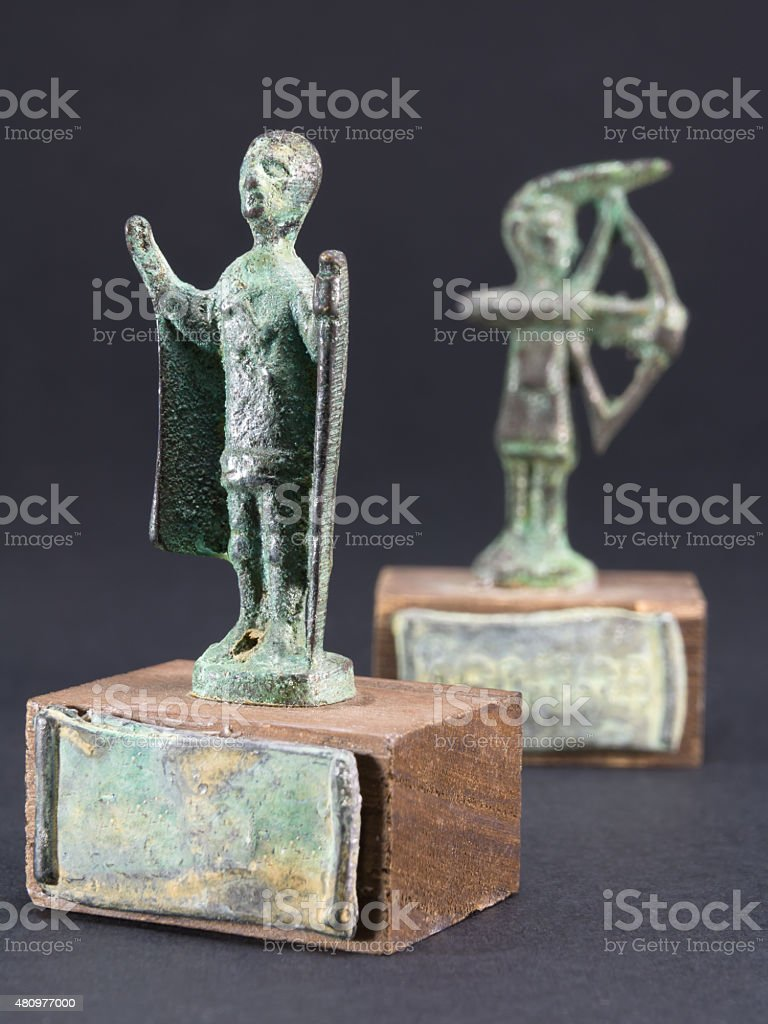 archer bronze statuette and chieftain praying with cloak and sti stock photo