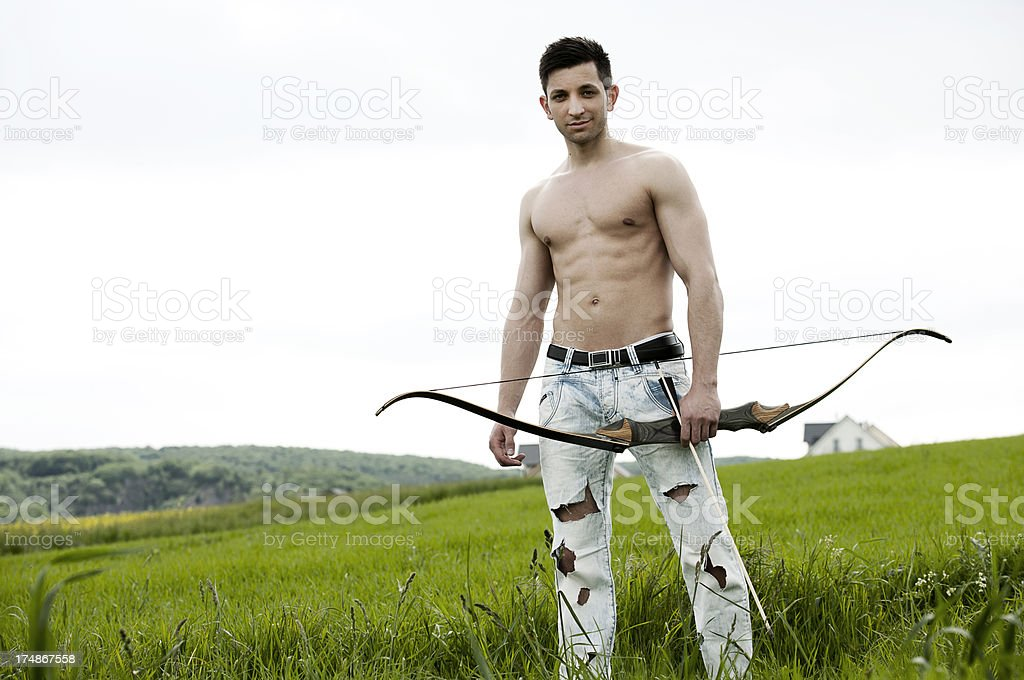 Archer in landscape royalty-free stock photo