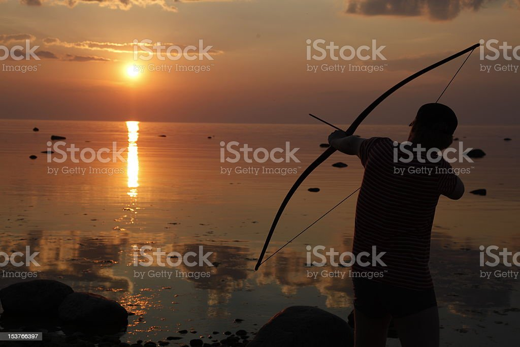 Archer in the sunset royalty-free stock photo