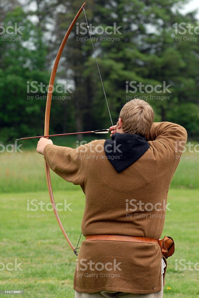 Archer shooting arrows at targets royalty-free stock photo