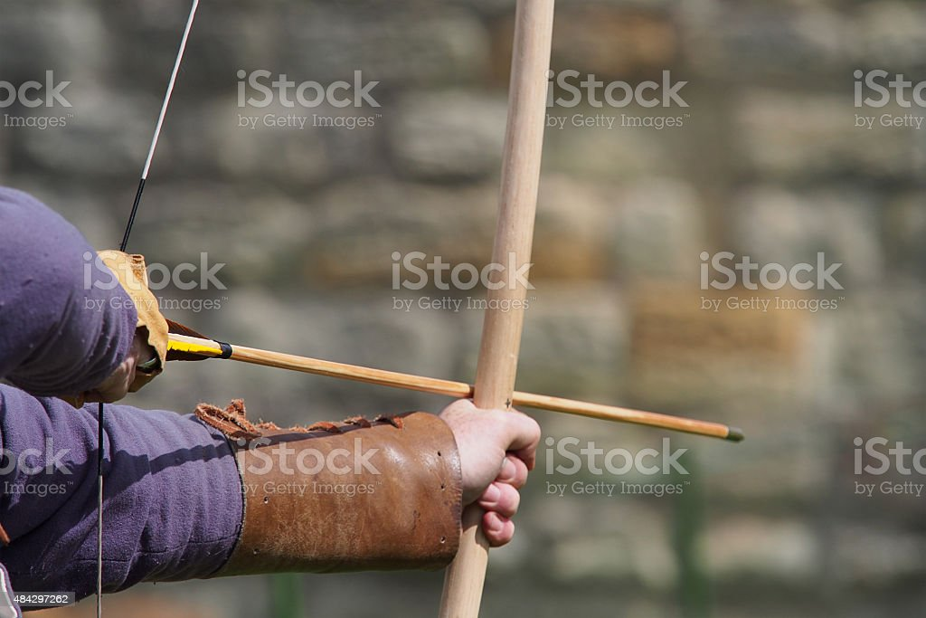 Archer taking aim with Longbow stock photo