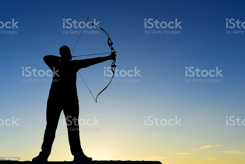 archer with bow and arrow stock photo