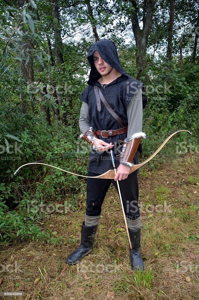 Archer with  coloured arrows in the quiver stands with bow stock photo