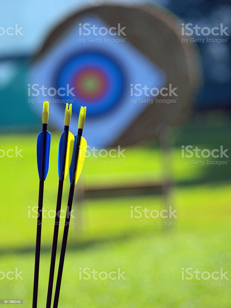 Archery arrows infront of target royalty-free stock photo