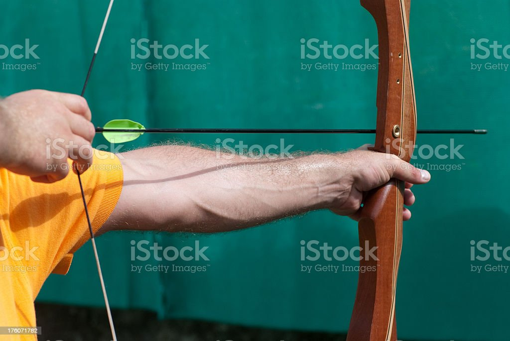 archery in action side view royalty-free stock photo