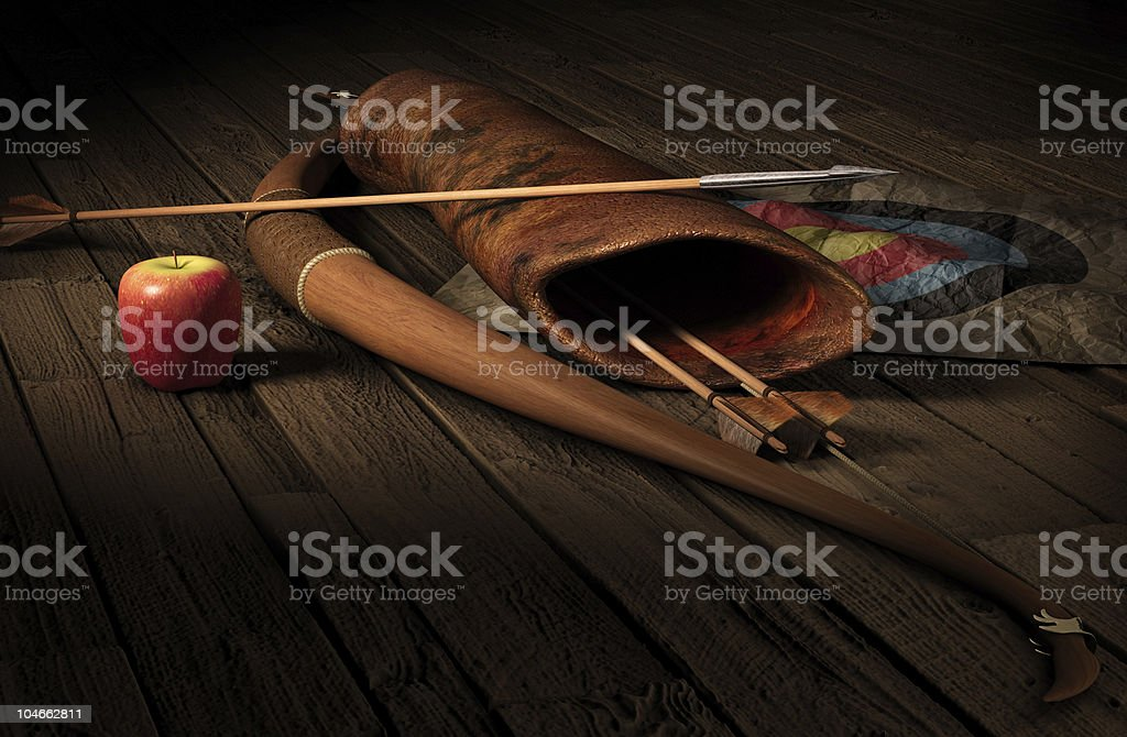 Archery set with a target and an apple on a wooden floor stock photo