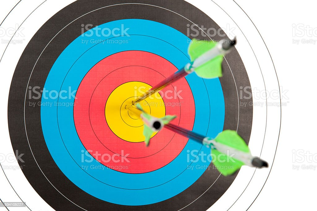 Archery target with three arrows stock photo
