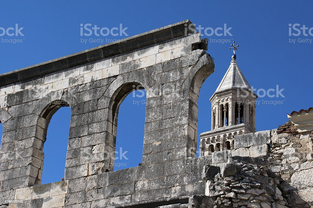 Arches and bell tower on blue sky stock photo