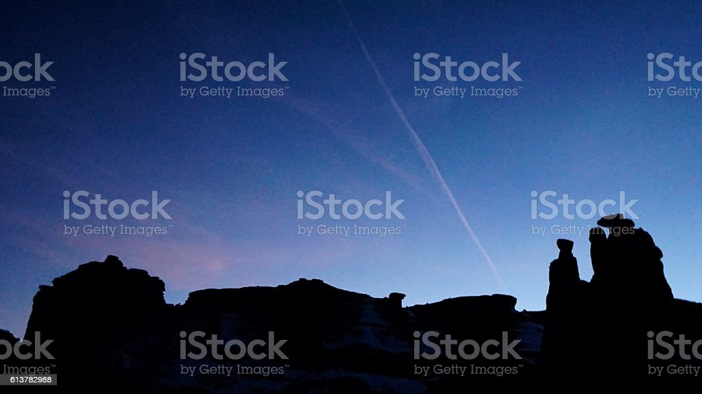 Arches National Park Courthouse Towers Angular Rock Formations Silhouette, Twilight stock photo