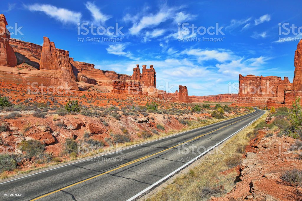 Arches National Park, Road with view of Three Gossips stock photo