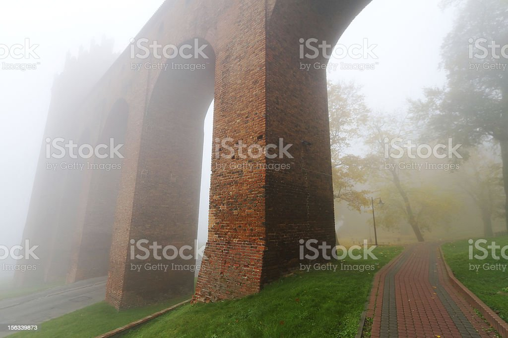 Arches of Kwidzyn Cathedral in fog stock photo