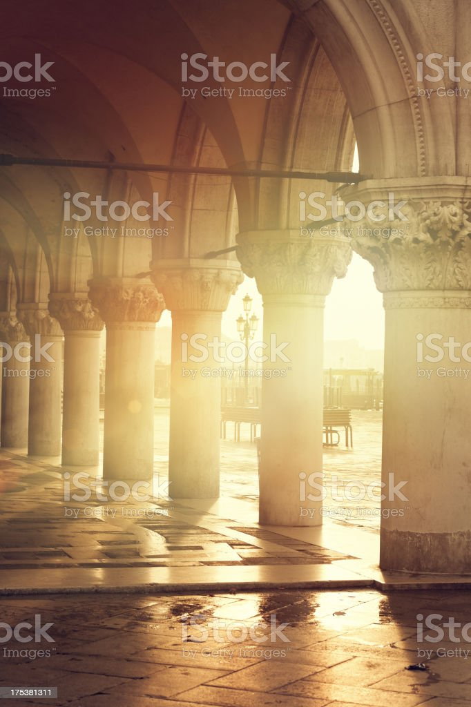 Arches of the Doges Palace Venice at sunrise stock photo
