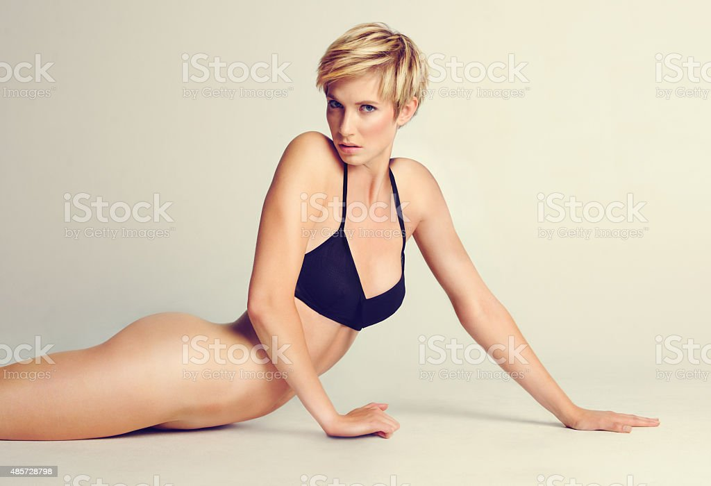 Arching her back for your benefit stock photo