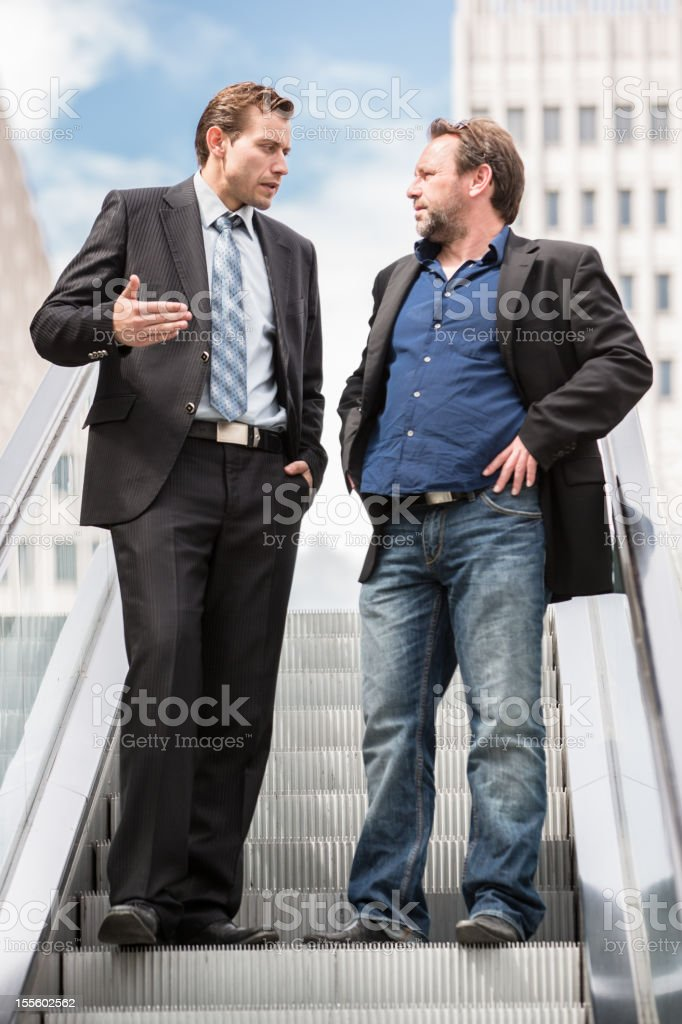 Architect and banker discussing project royalty-free stock photo