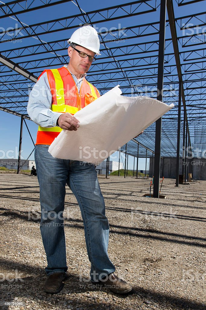 Architect and Blueprints stock photo