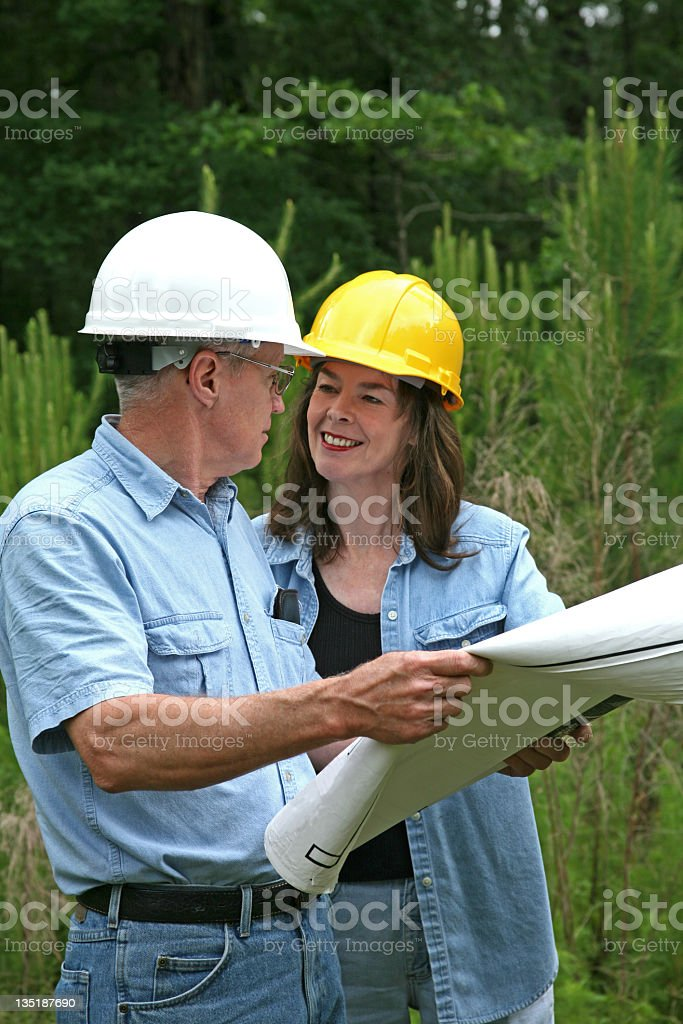 Architect and builder discussing plans for new construction royalty-free stock photo