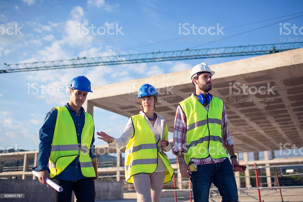 Architect and builders talking on site stock photo