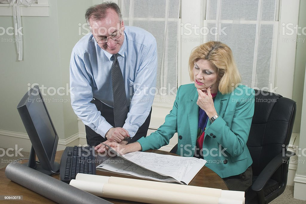 Architect And Client Looking At Blueprints 4 royalty-free stock photo