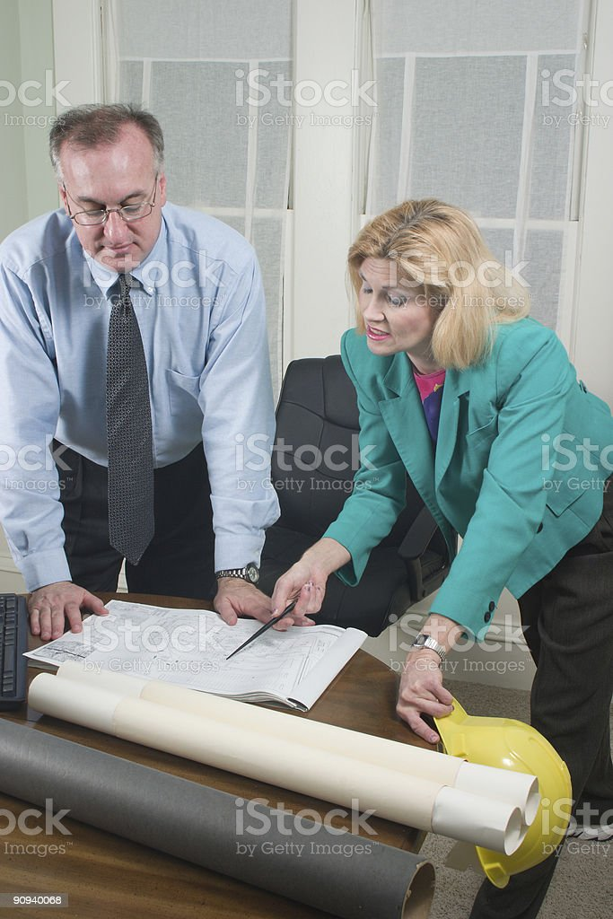 Architect And Client Looking At Blueprints 6 royalty-free stock photo