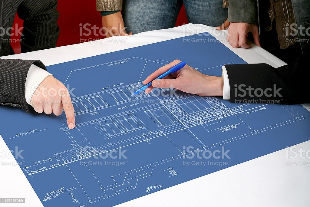 Architect and client meeting with blueprint royalty-free stock photo