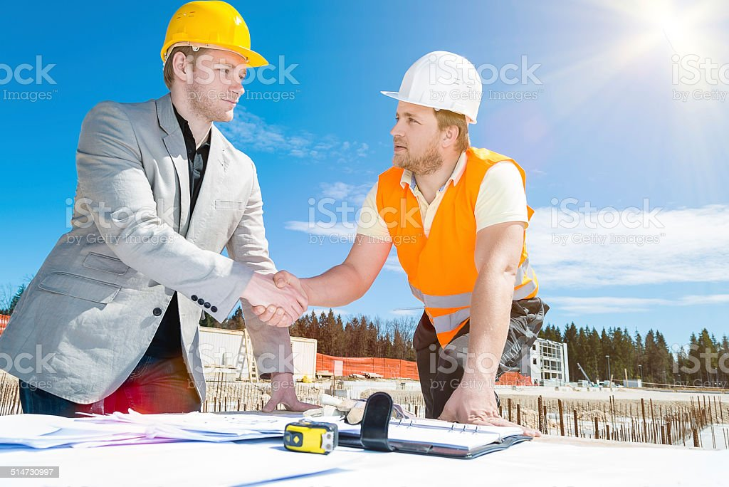 building activity construction worker construction handshake