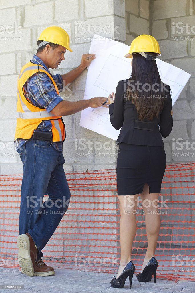 Architect and Construction Worker With Blueprint royalty-free stock photo
