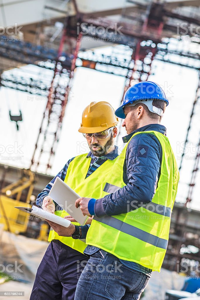 Architect and contractor discussing bridge building project stock photo