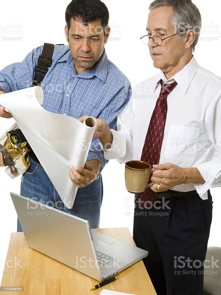Architect and Contractor Studying Blueprints stock photo