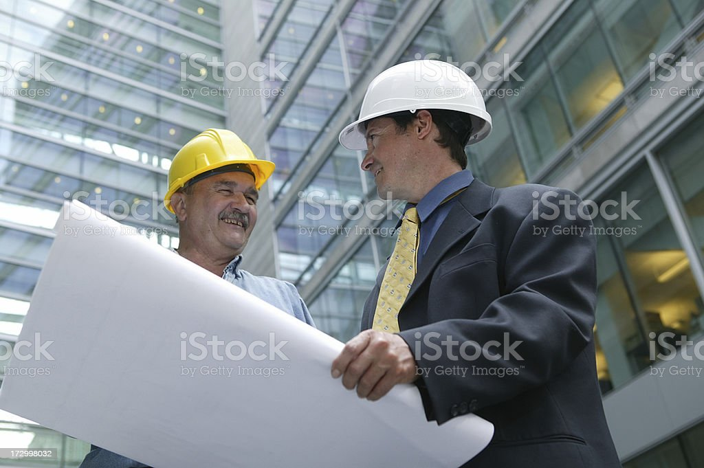 architect and foreman in front of a building site royalty-free stock photo