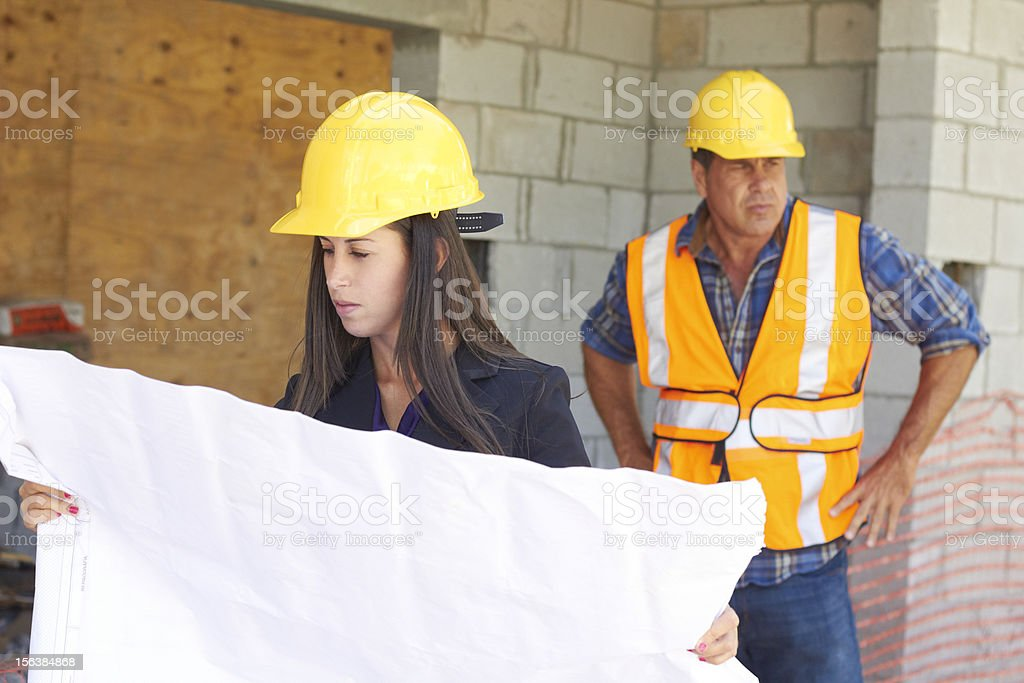 Architect and Foreman With Blueprint royalty-free stock photo