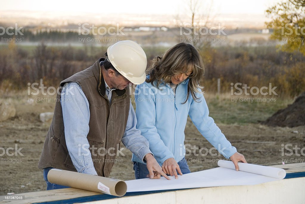 Architect and homeowner royalty-free stock photo