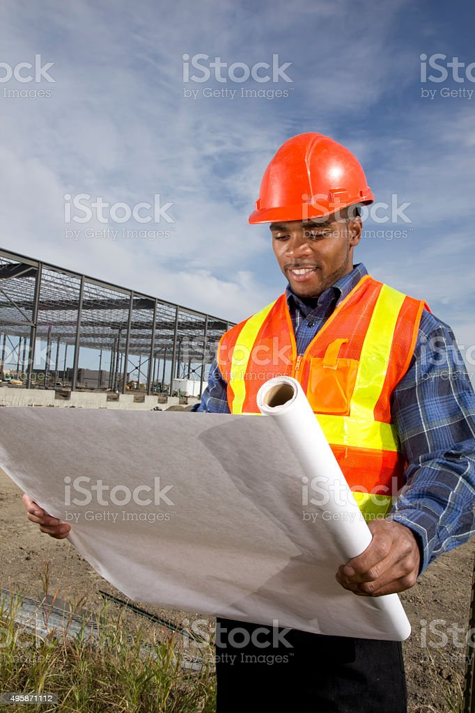 Architect at a Steel Frame Construction Site stock photo