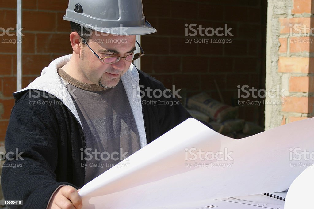 Architect checking plans royalty-free stock photo