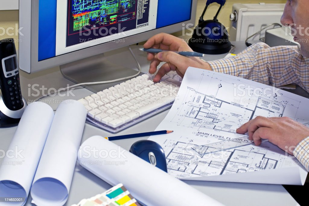 Architect checks plans on the computer royalty-free stock photo