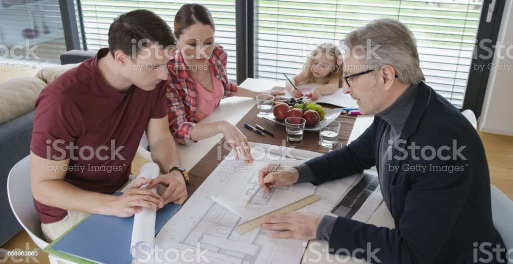 Architect consulting couple in their home stock photo