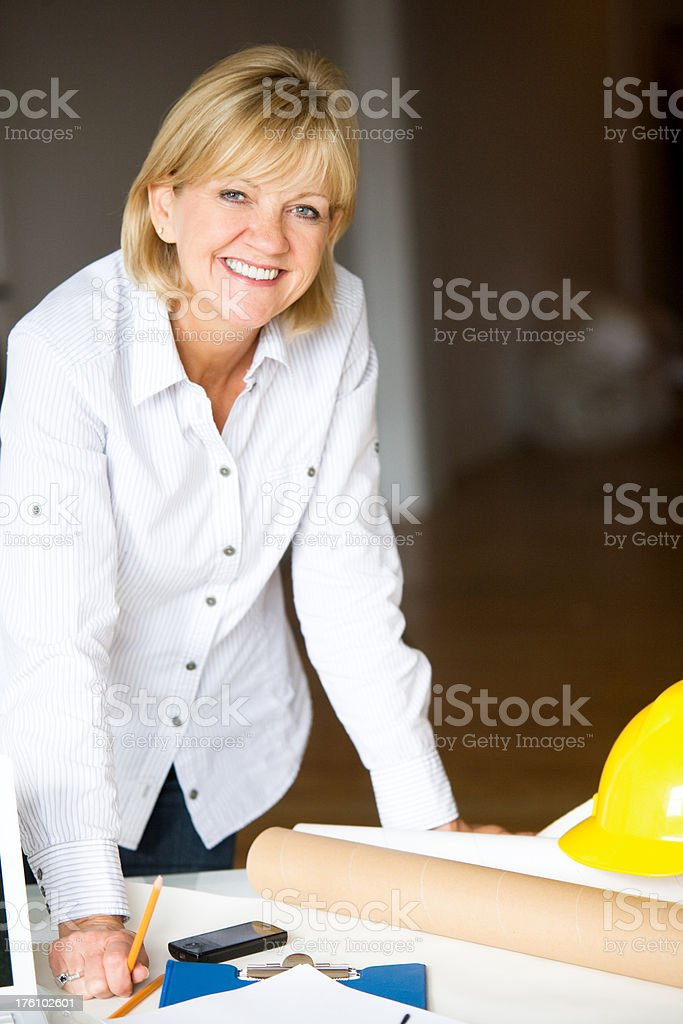 Architect Designer Woman Standing Desk in Office Happy Mature Adult royalty-free stock photo