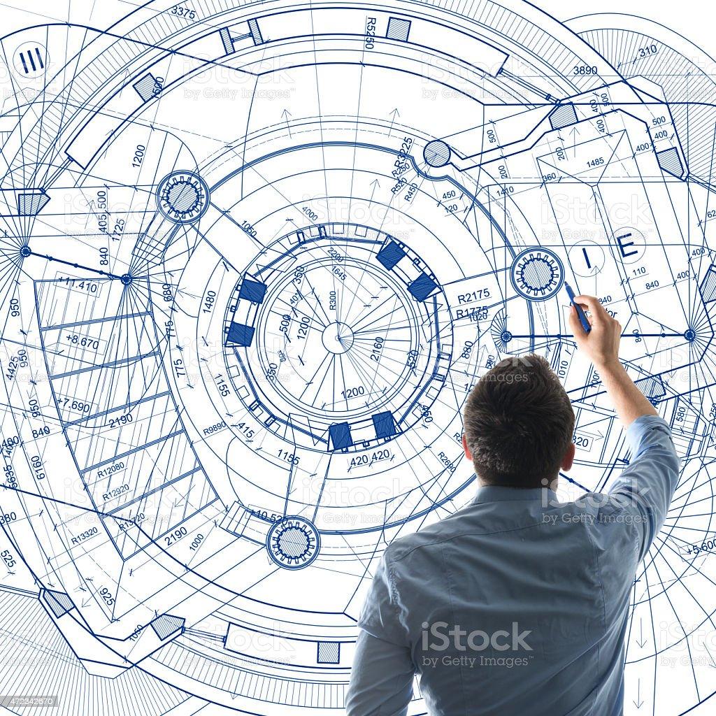 Architect designing on a big whiteboard stock photo